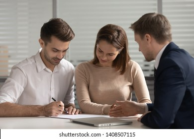 Young family couple customers clients sign paper mortgage investment contract sale purchase agreement take bank loan buying insurance service meeting broker agent make financial business leasing deal