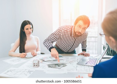 Young family couple purchase rent property real estate . Signing contract for buying house or flat or apartments. Dissatisfied, disappointed, layer buyer. scandal, quarrel concept