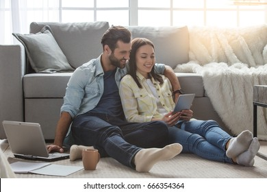Young family couple together at home casual