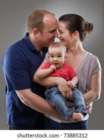 Young family with a cute baby girl happy. Happy lifestyle image.