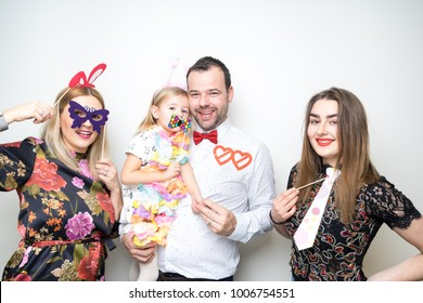 young family dad mom daughter baby sitter pose photo booth studio portrait props happy party wedding