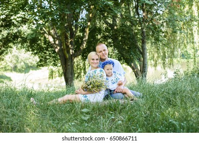 Young family with daughter having fun in nature