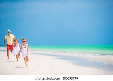 Young family enjoying beach summer vacation