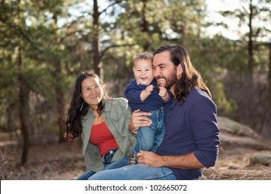 Young family enjoying a day in nature, shallow DOF, father and son in focus