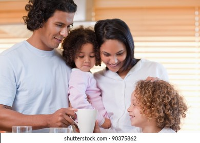 Young family enjoys having breakfast together