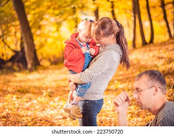 young family at fall forest