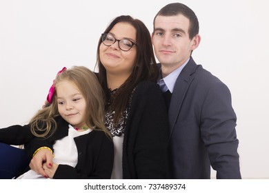 Young family Father, mother and daughter. White background