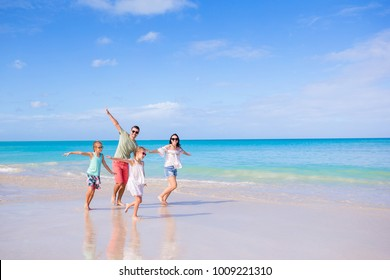 Young family of four on beach vacation