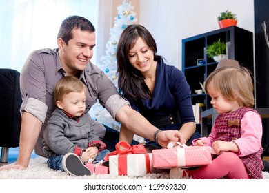 a young family getting Christmas gifts