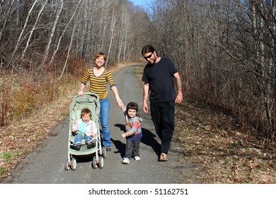 A young family going for a walk on a rural path