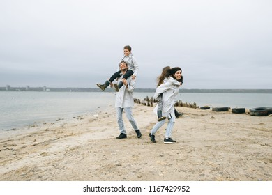 a young family have a fun near the sea on a boat background