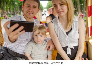Young family is having fun in the park during the summer