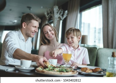 Young family having lunch in a restaurant