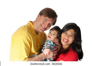 Young family isolated on white. Father is caucasian, mother is asian, multiethnic family.