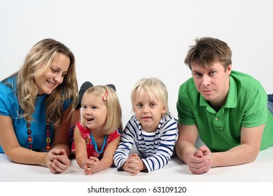 Young family with kids in studio