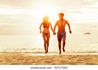 Young family in love having fun at beach,