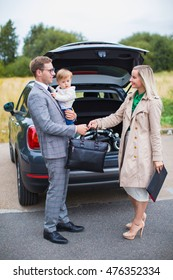 young family makes car purchase. transportation, business, shopping and ownership concept - customer and salesman shaking hands