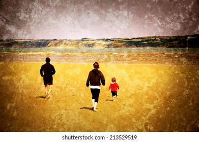 Young family (mother, father and little child) running towards the sea. Back view. Brittany, France. Retro aged photo with scratches.