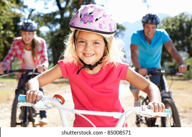 Young family on country bike ride
