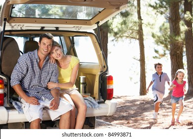 Young family on day out in country