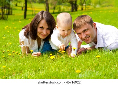 Young family on green grass