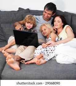 Young Family on a sofa with laptop