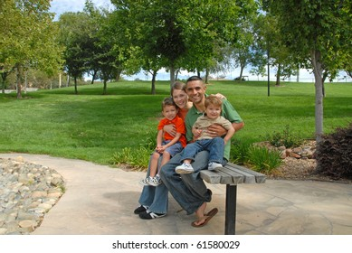 Young Family At Park