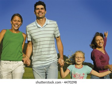 Young family is playing around on a sunny day. keyword for this collection is family7
