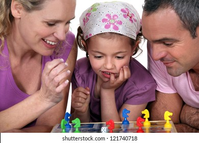 Young family playing a board game