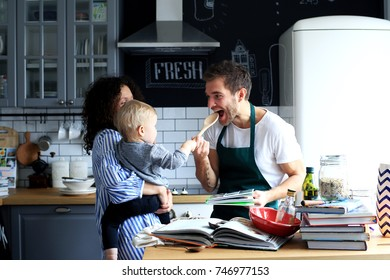 Young family preparing lunch in the kitchen