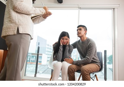 Young family  at a reception of psychologist