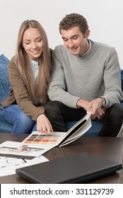 Young family selects house wall colors from samples