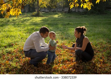 Young family sharing love in the autumn nature background