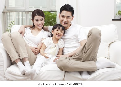 Young family sitting in couch