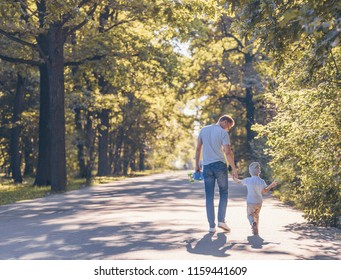 Young family with a skateboard outdoors