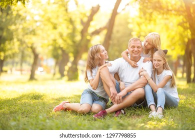 Young family with smiles and children in nature