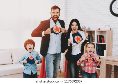 Young Family In Suits Are Hiding A Superhero Side.. Time For Action. Double Life. Alter Ego. Ger Ready. Save The World. Strong And Powerful. Hidden Personality. Confidence And Bravery.