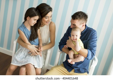 Young family with two daughters in the room