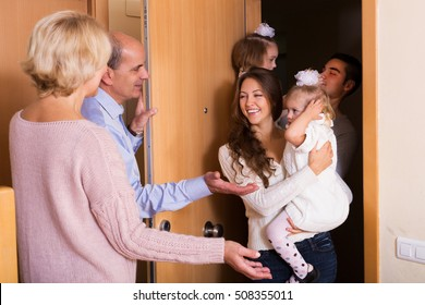 young family with two daughters visiting grand parents