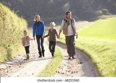 Young family walking in park