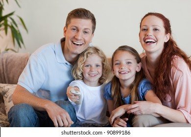 Young family watching a funny movie