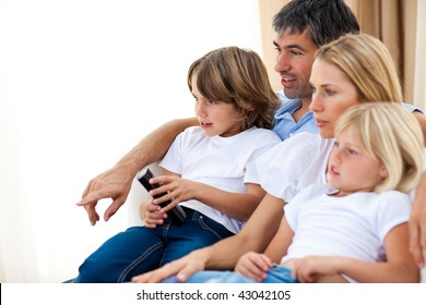 Young Family watching TV in the living-room