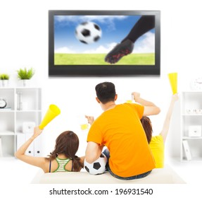 young fans yelling  and while watching soccer game