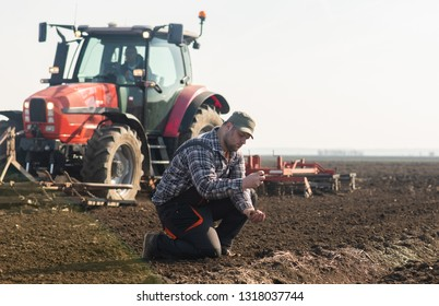Young farmer dirt while tractor is plowing fields