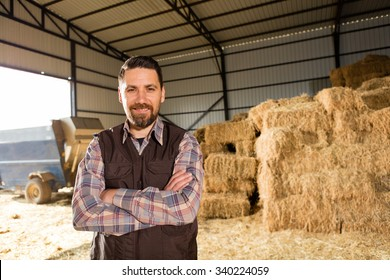 Young farmer in hayloft.