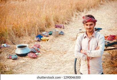 A young farmer standing around an agricultural field in Bangladesh