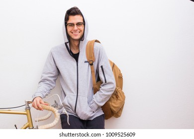 young fashion with backpack and bike on the wall