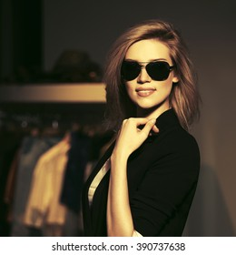 Young fashion blond woman in sunglasses at the mall