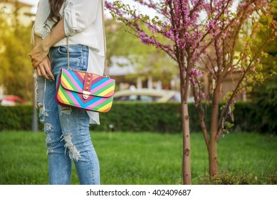 Young fashion business woman with handbag in spring