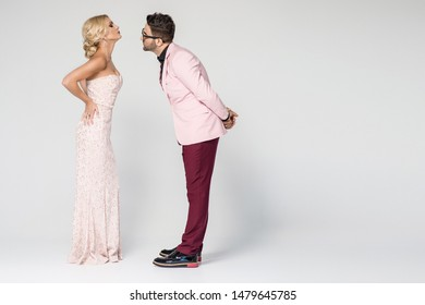 Young fashion couple on a background in studio